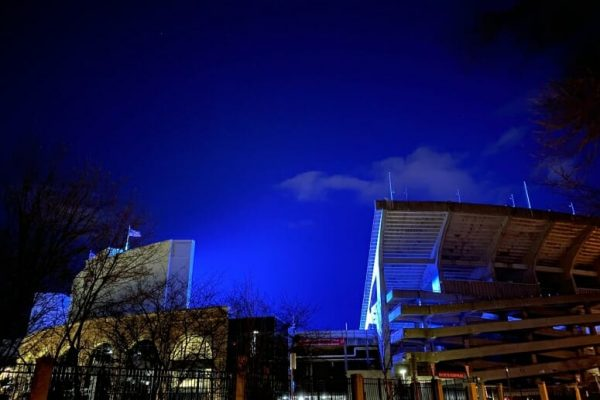 Camp Randall Stadium lit up in blue